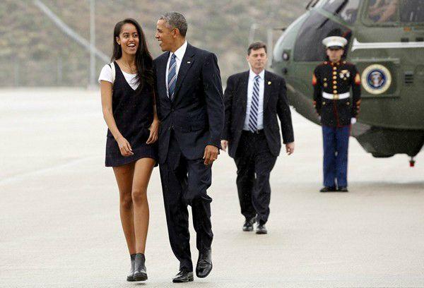 Malia Obama and Barack Obama