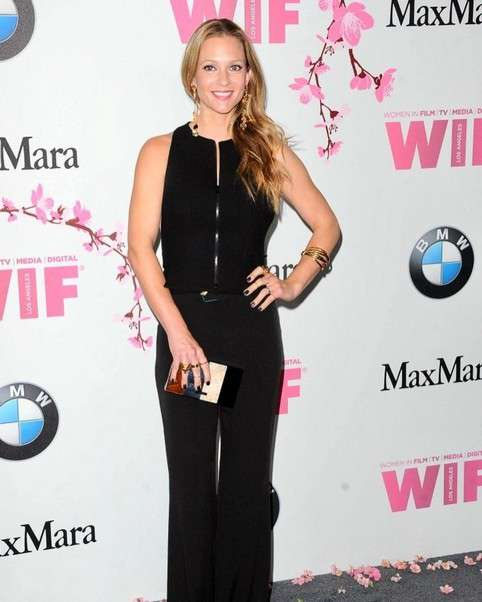 A. J. Cook in a black pantsuit